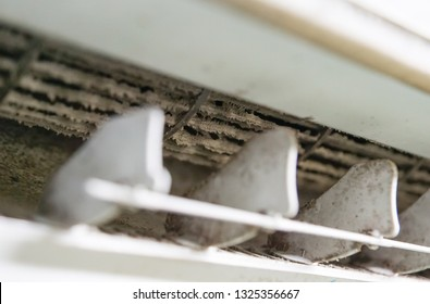 Closeup of dirty air conditioner full of dust