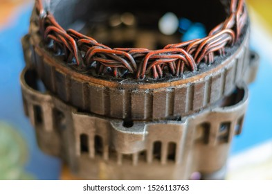Close-up of a dirty stator of a disassembled car generator. Selective focus. Side view. Eye level shooting.