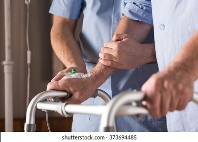 Close-up of disabled person walking with assistance
