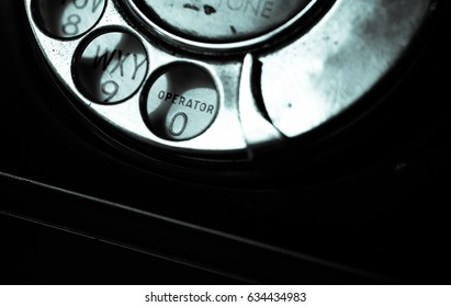Close-up disk with numbers on retro telephone. Horizontal indoors shot.