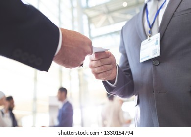 Close-up of diverse business people exchanging business card in conference