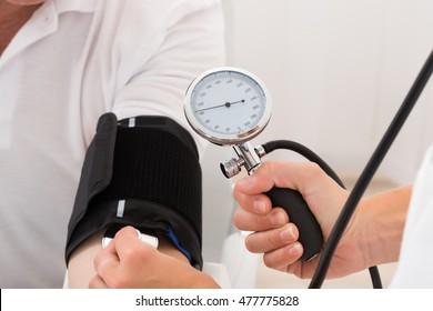 Close-up Of A Doctor Checking Blood Pressure Of Patient