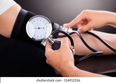 Close-up Of A Doctor Checking Blood Pressure O Patient