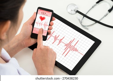 Close-up Of Doctor Holding Mobile Phone With App For Health
