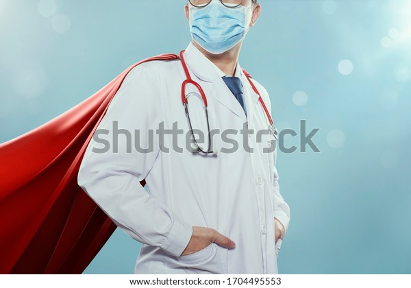 Closeup Doctor with mask and cape hero, fight against coronavirus pandemic concept .
