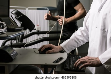 Closeup of a doctor supervising examination of a sportsman on the computer screen