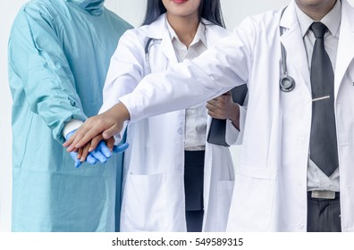 Close-up of doctor teamworking,Anesthesiologist,General Surgeon, General internists making pile of hands