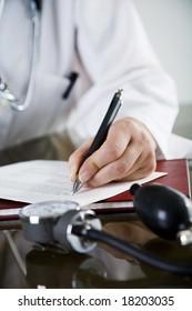 closeup  of doctor writing a prescription