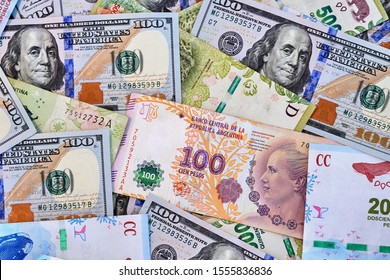 Close-up of dollars and Argentine pesos
