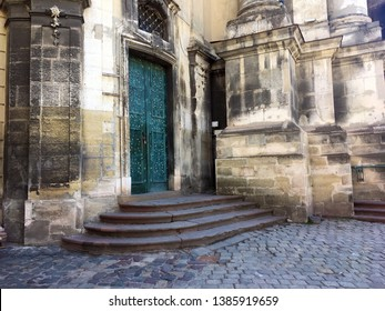 Closeup of Dominican Church in Lviv. Old building with staircase. Entrance Stairs The Door Old. Door to the Catholic Church. Stairs to the Church