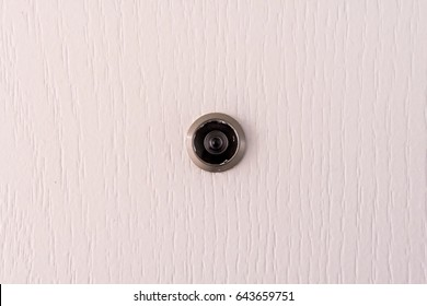 Close-up of a Door Eye on the wooden gate.