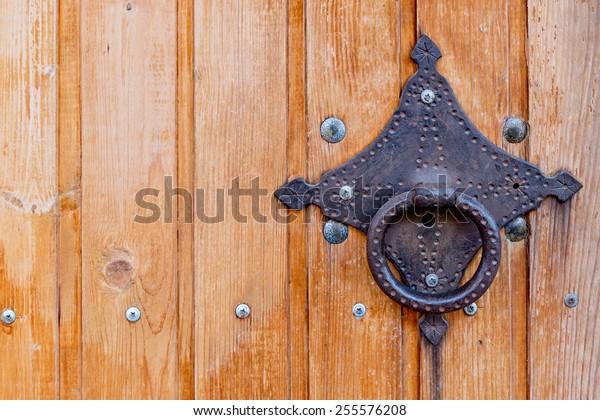 Closeup of the door with vintage doorknob, a lot of copyspace