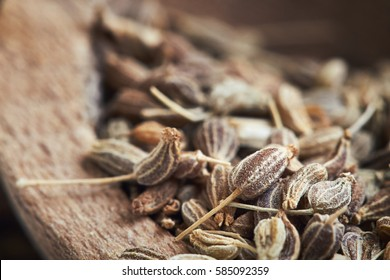 Close-up of dried anise seed (aniseed) in wooden bowl