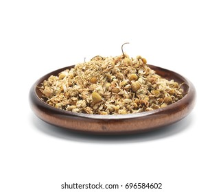 Closeup of dried chamomile isolated on white background.