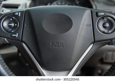 Closeup of Driver Airbag on a car steering wheel