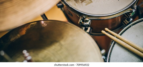 Closeup of drumsticks lying on the drum set. Drummer equipment