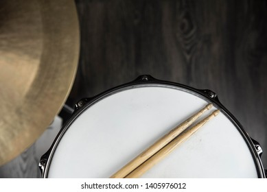 Closeup of drumsticks lying on the professional drum set. Drummer equipment.
