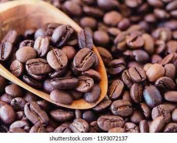 close-up dry coffee beans. unmilled turkish coffee beans with spoon