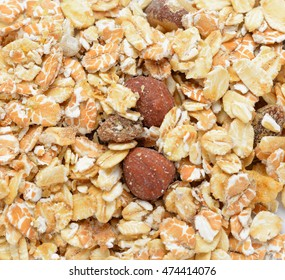Close-up of dry muesli with nuts from above, cerea
