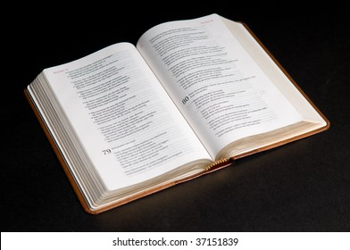 Closeup of a Dutch Bible on a black background