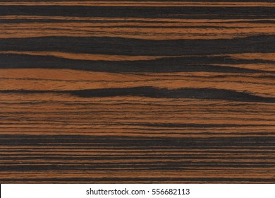 Closeup ebony wood surface as background. Extremely high resolution photo.