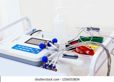 Closeup ECG machine for patient at the hospital. Heart electrocardiogram. EKG equipment on the white background.