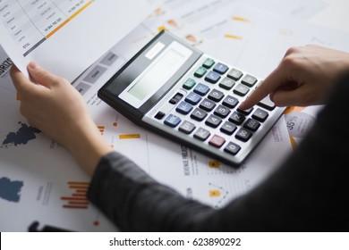 Closeup of Economist Using Calculator