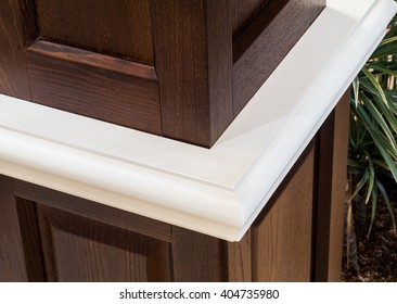 Closeup of edge of wooden table or commode