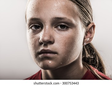 Closeup of edgy softball girl looking tough with sweat