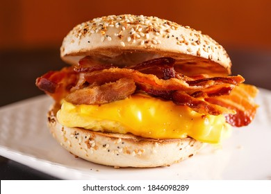 Close-up of a egg, bacon and cheese sandwich on a sesame seed  bagel