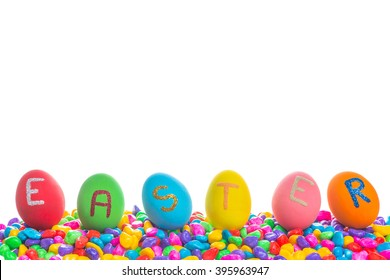 """Close-up of eggs of different colors with text """"Easter"""". On colorful stones with white background."""