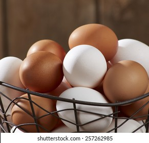 Closeup of Eggs in wire basket on wood