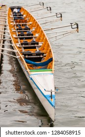 Close-up of an eight that is a rowing boat used in the sport of competitive rowing. It is designed for eight rowers, who propel the boat with sweep oars, and is steered by a coxswain, or cox.