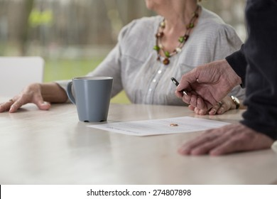 Close-up of elder man signing divorce documents