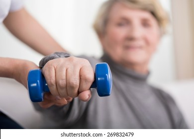 Close-up of elder woman training with physiotherapist