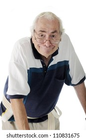 Closeup of an elderly man with a humorous expression.  He's hunched forward while walking with a walker (not visible) and wearing a gait belt.  On a white background.