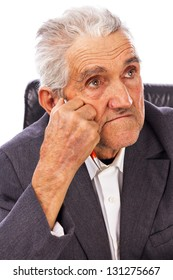 Closeup of an elderly man looking away in deep thought isolated on white background