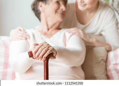 Close-up of elderly woman holding walking stick in the nursing house