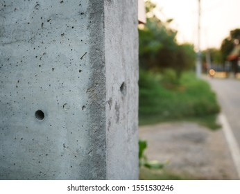 closeup of electric concrete pole.