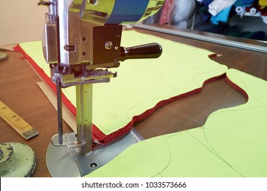 Closeup of an electric cutter in a workshop for cutting material. Sewing production line.