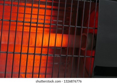 close-up of electric heater on fire in a room