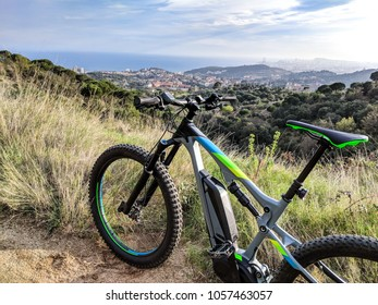 Closeup of an electric mountainbike parked on a single track path just before dawn