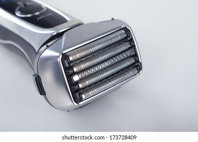 Closeup of Electric Shaver Against White. Horizontal Image