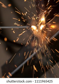 Close-up of electric welding spot producing high temperature and sparks