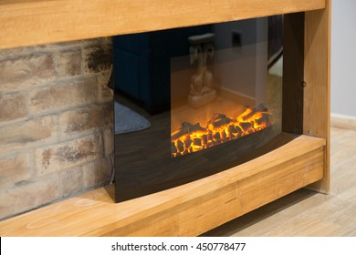 Close-up of electrical fireplace in living room