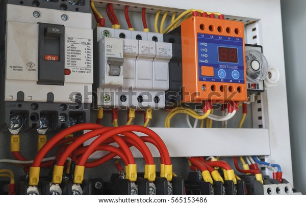 close-up electrical wiring with timer and contactors