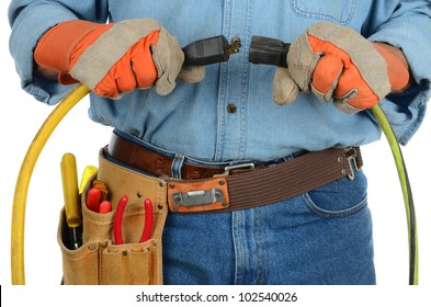 Closeup of an electrician plugging two extension cords into each other. Horizontal format over a white background. Man is unrecognizable