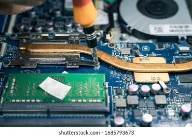 A close-up of an electrician repairing a computer circuit board,close up electrician hands are working with soldering iron