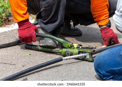Close-up of electricians' equipment To clamp the metal to connect the largely broken wires Using a metal pipe, electrical insulation is plugged into the broken wire using a large clamp.
