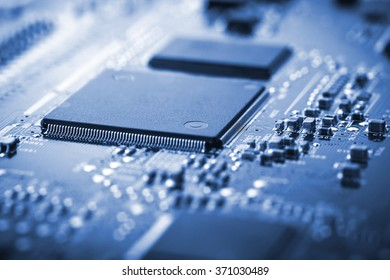 Closeup electronic board - microelectronics. Colorized. Very small field of sharpness.